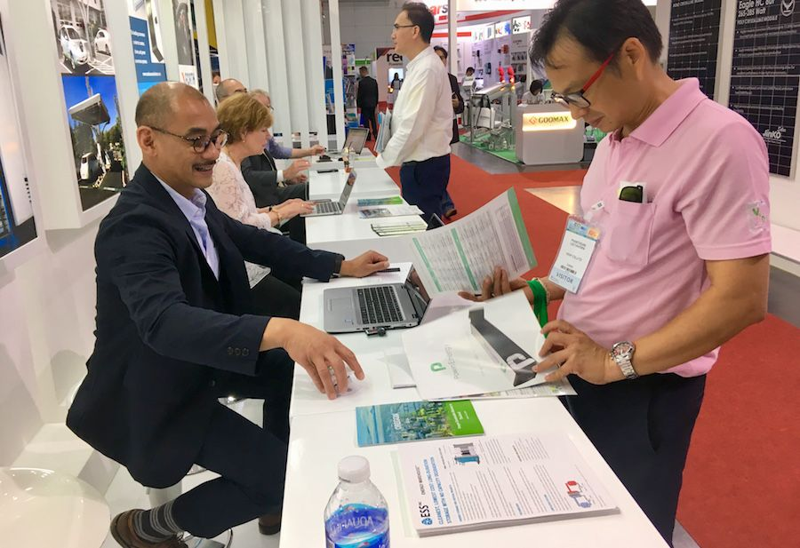 Clark Aganon, director of market development for Powin Energy, greets attendees at Oregon's booth at ASEAN sustainable energy week