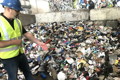 Scott Farling, vice president, business development and research at Titus MRF Services, shows plastic waste that is being recycled at the Pacific Northwest Secondary Sorting Demonstration project in Southeast Portland