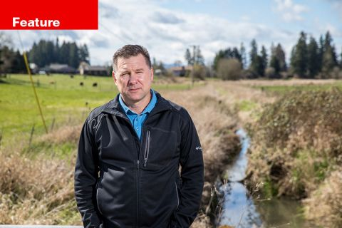 Curt VanderZanden stands in front of Storey Creek, which marks the line of the urban-growth boundary in Hillsboro.