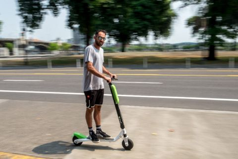 George Isahakyan takes his first ride on a Lime scooter along SW Naito Parkway.
