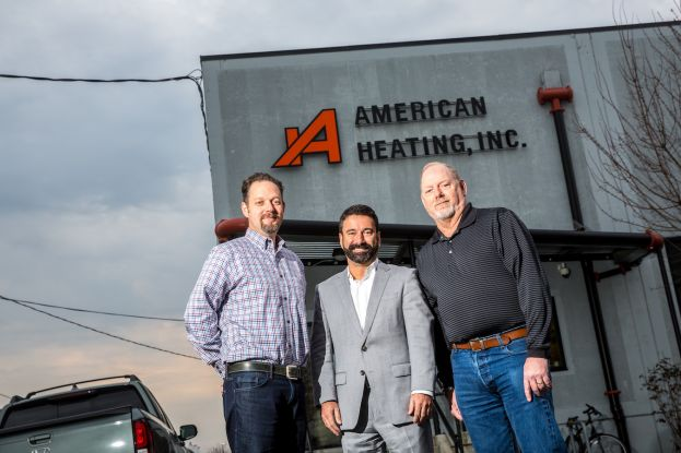 Cyrus Vafi (middle) of Banner Bank with Joe Paine and Brian Shea of American Heating