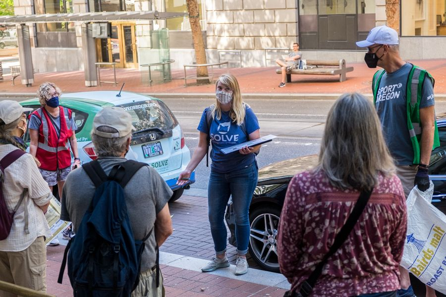 SOLVE communications and outreach director Larissa Gordon provides instructions to volunteers before starting he clean-up of downtown Portland