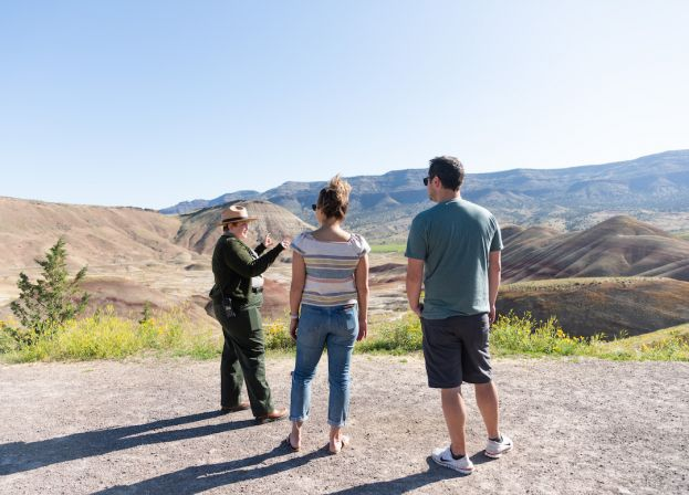 Visitors talk with a park ranger overlooking the Painted Hills near Mitchell, Oregon.