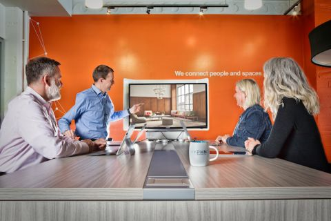 Hyphn's people enjoy multiple different collaboration spaces and technologies throughout their own space.
