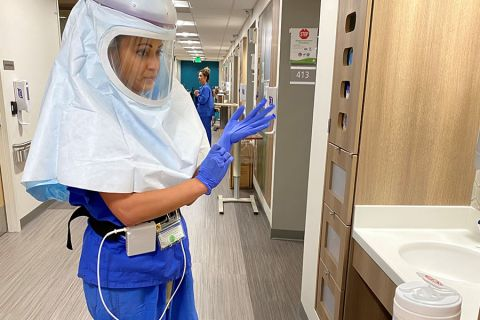 A Legacy Health worker takes precautions in COVID-19 gear