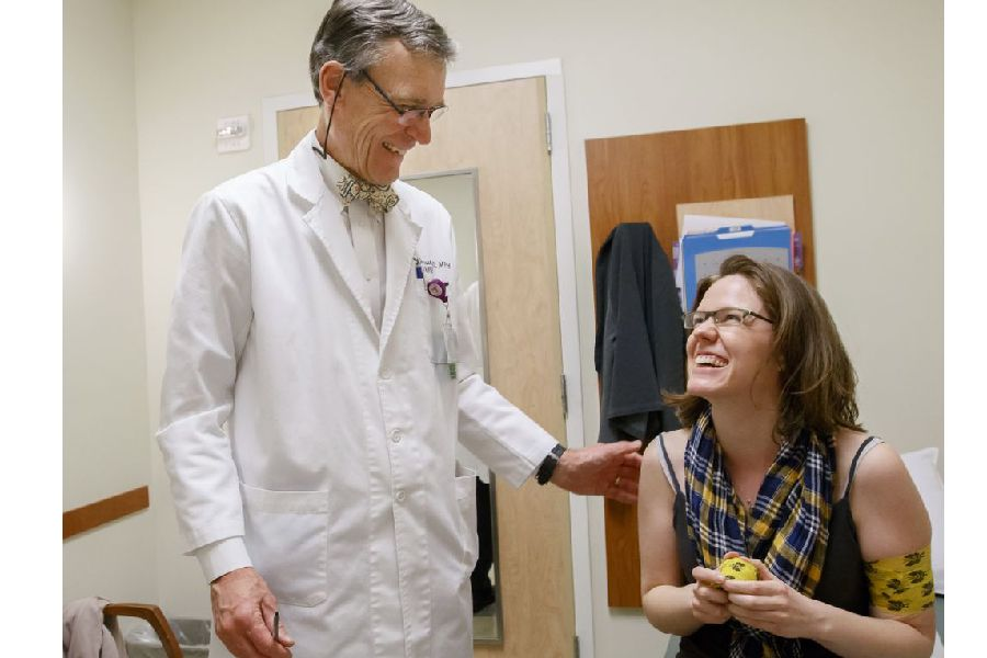 Dr. Jeff Jensen, head of OHSU women's health research unit, meets with a patient