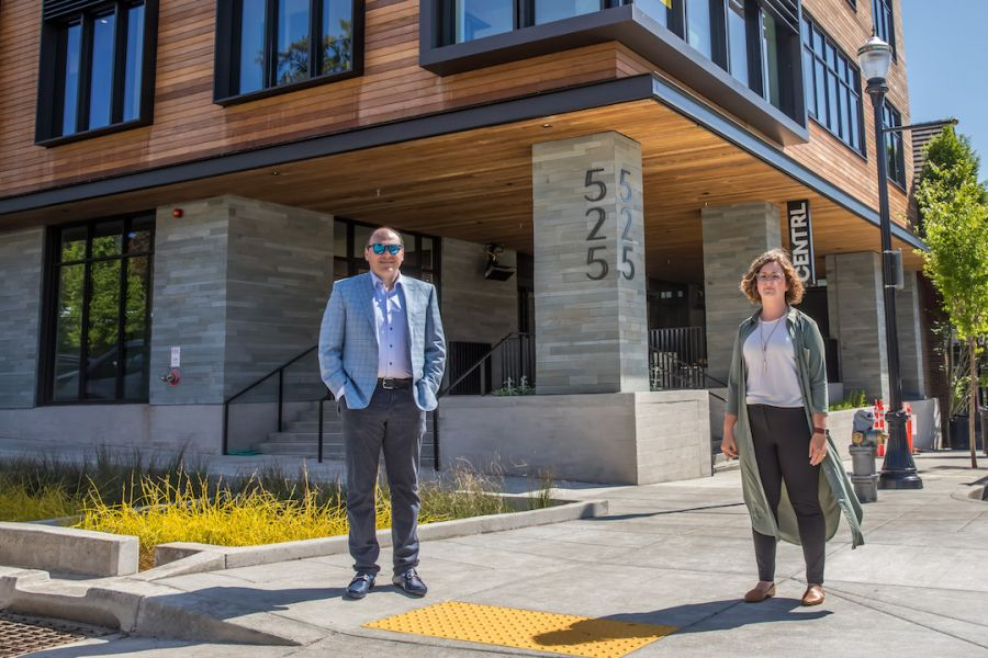 Shareholder Graham Petersen and Assurance Manager Beth Morgan maintain social distance while standing outside the new CENTRL office in Lake Oswego.