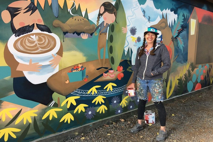 Megan Myers stands beside her mural outside The Humble Beet on Newport Avenue in Bend.