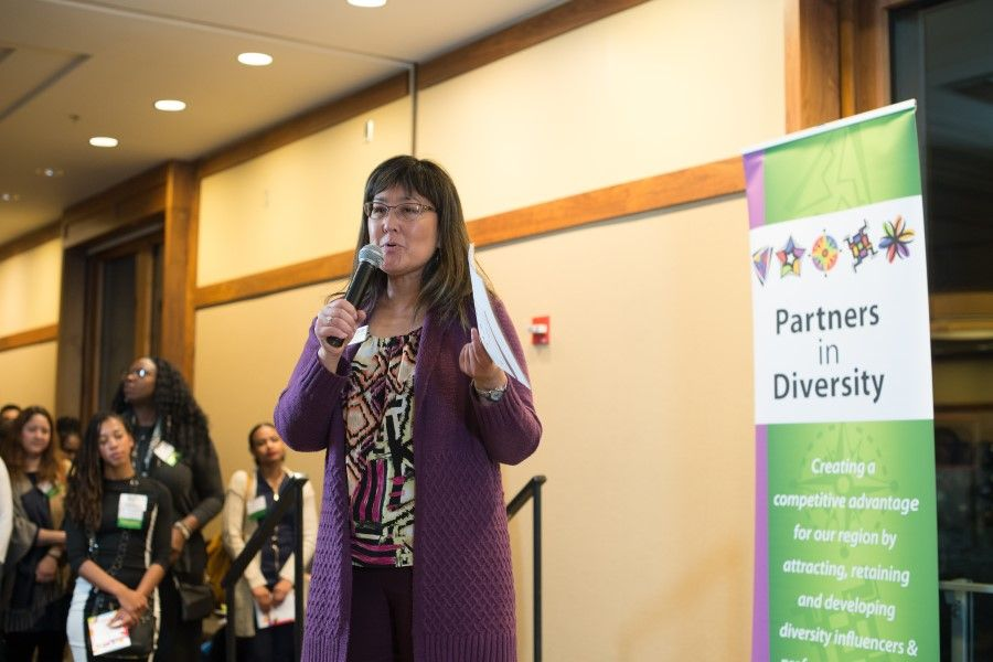 Mari Watanabe, executive director of Partners In Diversity, speaks at 'Say Hey' event at the Multnomah Athletic Club in Portland