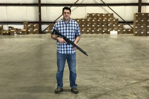 Josh Underwood, CEO/owner of Radian Weapons, holding one of his company's AR-15s in his new 18,000 square foot warehouse in Redmond