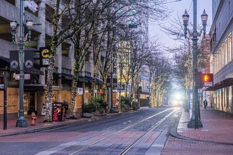 A Portland downtown street with boarded-up storefronts
