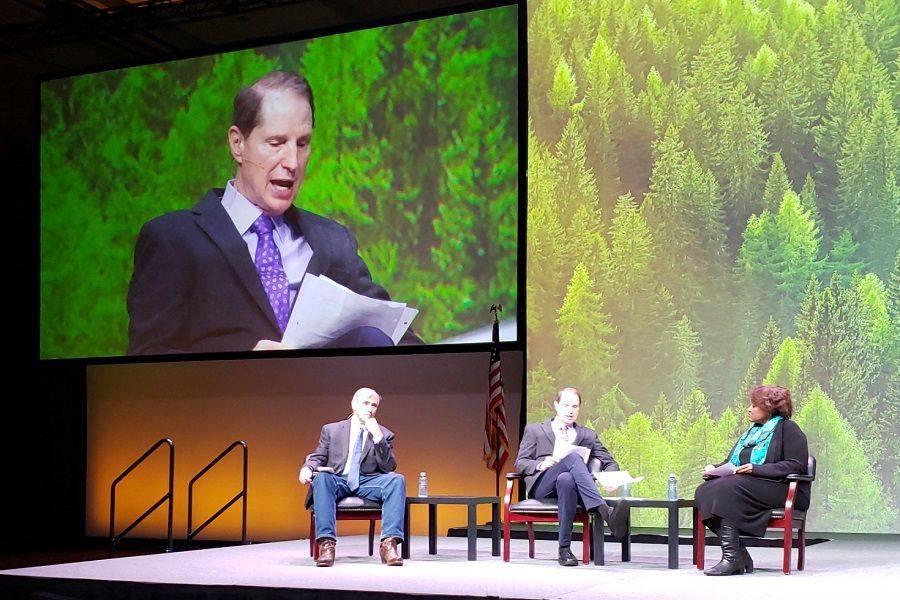 Ron Wyden and Jeff Merkley and Ruth Williams-Brinkley at the Northwest Economic Development Conference last year